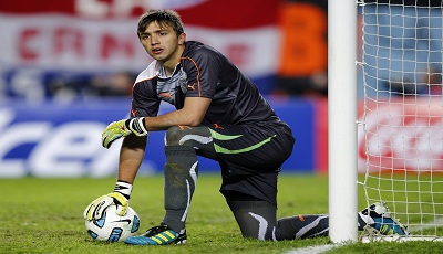 Uruguay's goalkeeper Fernando Muslera pauses during their semi-final soccer match against Peru at the Copa America in La Plata